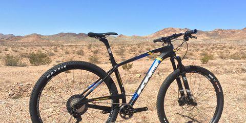Land vehicle, Bicycle, Bicycle wheel, Vehicle, Bicycle part, Spoke, Bicycle frame, Bicycle tire, Mountain bike, Bicycle handlebar,