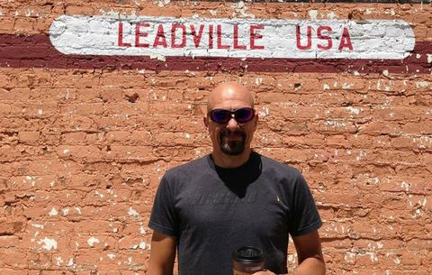 TJ Klausutis in front of leadville sign