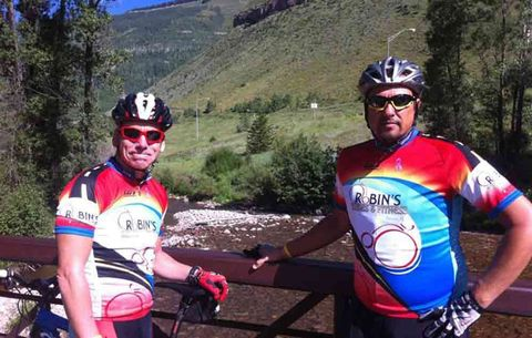 TJ Klausutis riding with a friend in a colorful jersey