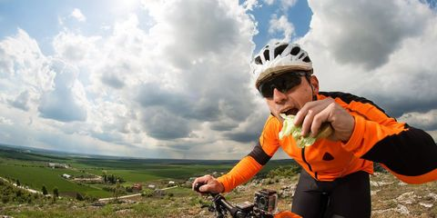 happy cyclist eating snack