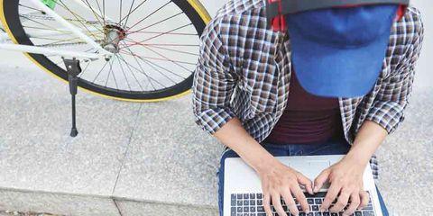 cyclist on computer