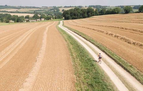 woman riding bike on a gravel road