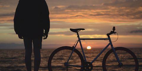 cyclist watching sunset