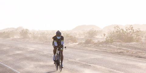 RAAM winner Sarah Cooper riding on the dusty open road