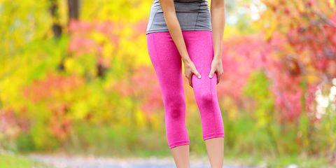 woman rubbing sore legs