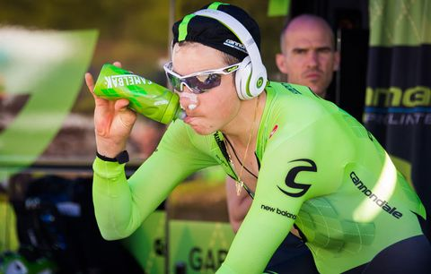 cannondale rider hydrating on trainer