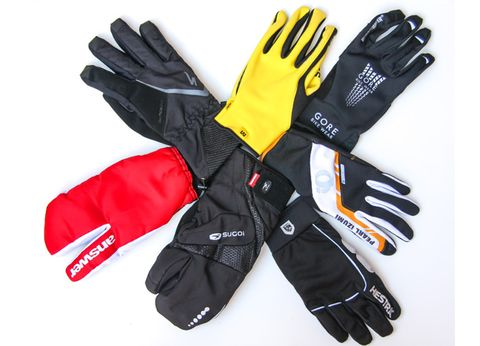 Sports gear, Personal protective equipment, Glove, Safety glove, White, Black, Motorcycle accessories, Thumb, Gesture, Workwear,