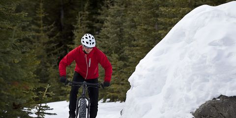 Cyclist riding in snow