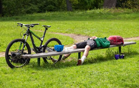 tired man near mountain bike