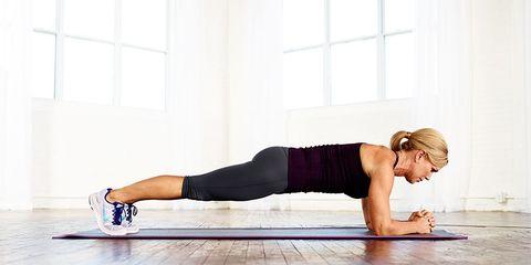 woman planking on wood floor