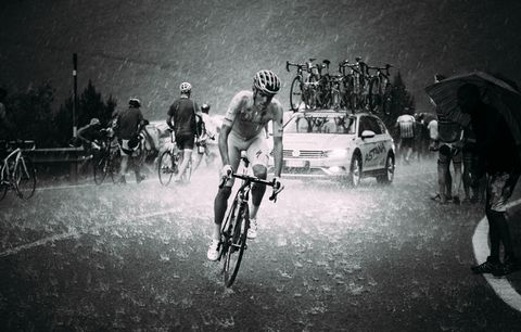 cyclist riding in the rain