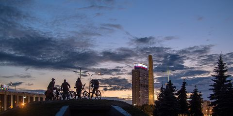 Riders at dusk with the city in the background