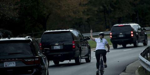 Woman on Bike Flips Off Trump Motorcade