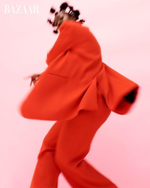 tatiana desardouin in red suit pink background