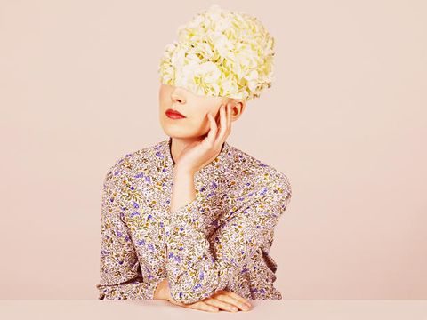 Sleeve, Headpiece, Headgear, Hair accessory, Artificial flower, Costume, Fashion design, Pom-pom, Portrait photography, Portrait,