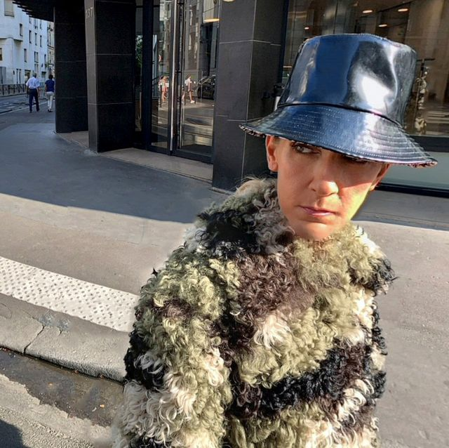 Fur, Road, Street, Eyewear, Infrastructure, Headgear, Sidewalk, Street fashion, Asphalt, Sunglasses,