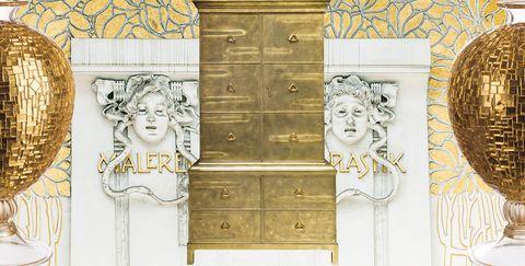 Furniture, Wall, Room, Chest of drawers, Door, Wallpaper, Art, Molding, Cupboard, Facade,