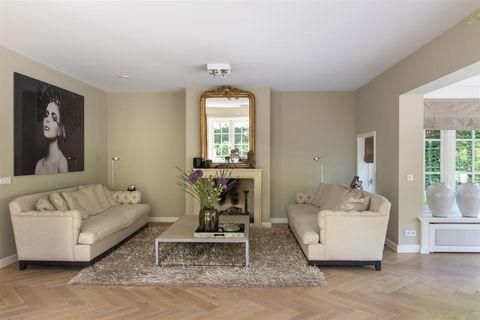 Living room, Room, Furniture, Property, Interior design, Building, Floor, Laminate flooring, Ceiling, Home,