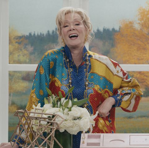 jean smart in a multicolored blouse on set of her new show hacks