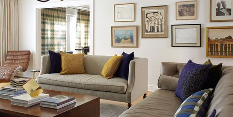 Living room, Furniture, Room, Interior design, Couch, Property, Wall, Yellow, Home, Coffee table,