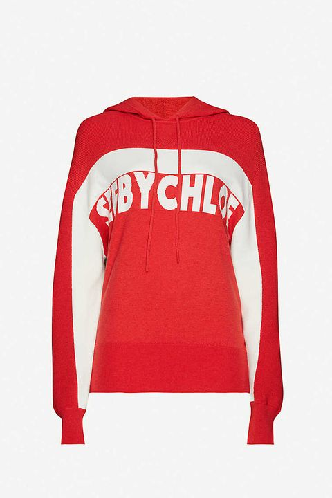 still life shot of red and white see by chloe knitted hoodie from selfridges