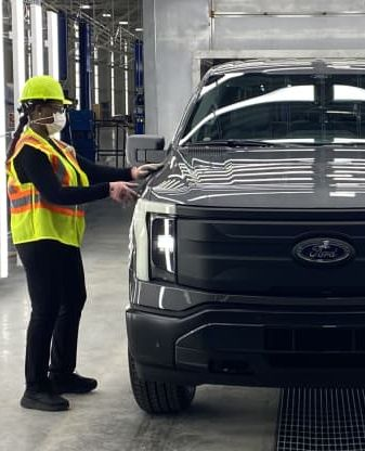person working on new ford