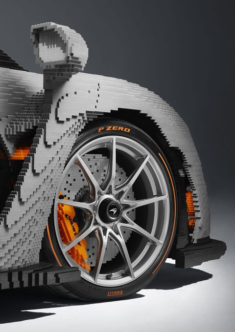 Tire, Wheel, Automotive tire, Vehicle, Rim, Alloy wheel, Automotive design, Orange, Spoke, Auto part,