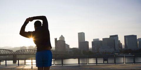 Human leg, Elbow, Shorts, Tower block, Metropolitan area, Active shorts, Knee, Metropolis, Morning, Calf,