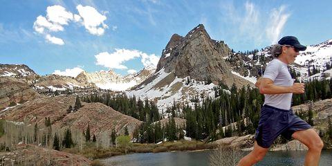 Footwear, Leg, Sky, Mountainous landforms, Shoe, Mountain range, Landscape, Active shorts, T-shirt, Shorts,