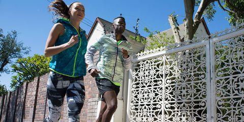 Human leg, Shorts, Active shorts, Bermuda shorts, Trunks, Calf, board short, Walking shoe, Backpack, Fence,