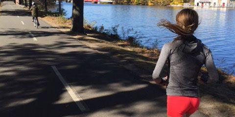 Liz Costello runs along the Charles River in Boston.