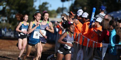 Weini Kelati leads Maryjeanne Gilbert at the Foot Locker girls cross country championships.