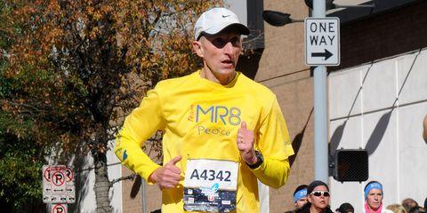 Photo of William Evans, Boston Police Commissioner, running the 2016 Houston Marathon