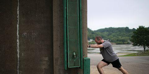 Edwin Warnick stretching on wall in Huntington, WV