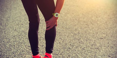 Runner with sore muscles