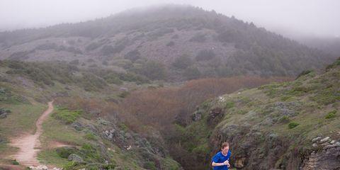 Runner on trail in Point Reyes, California