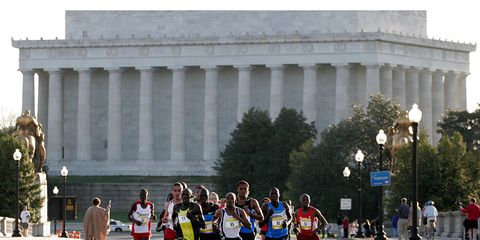 Runners in front of a monument
