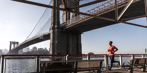 Man running near Brooklyn Bridge