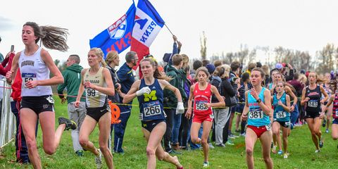 Erin Finn races without shoes at the 2015 NCAA cross-country championships.