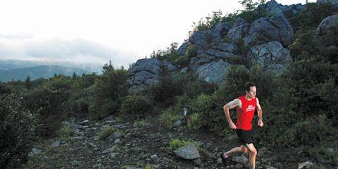 Eric Grossman running on trail