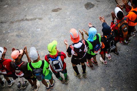 Social group, Helmet, Community, Personal protective equipment, Team, Adventure, Sports gear, Skating, Outdoor shoe, Roller skates,