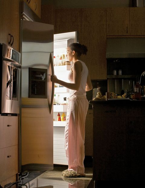Woman eating late at night.