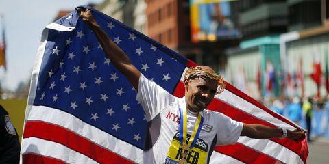 Meb Keflezighi celebrates his 2014 Boston Marathon win
