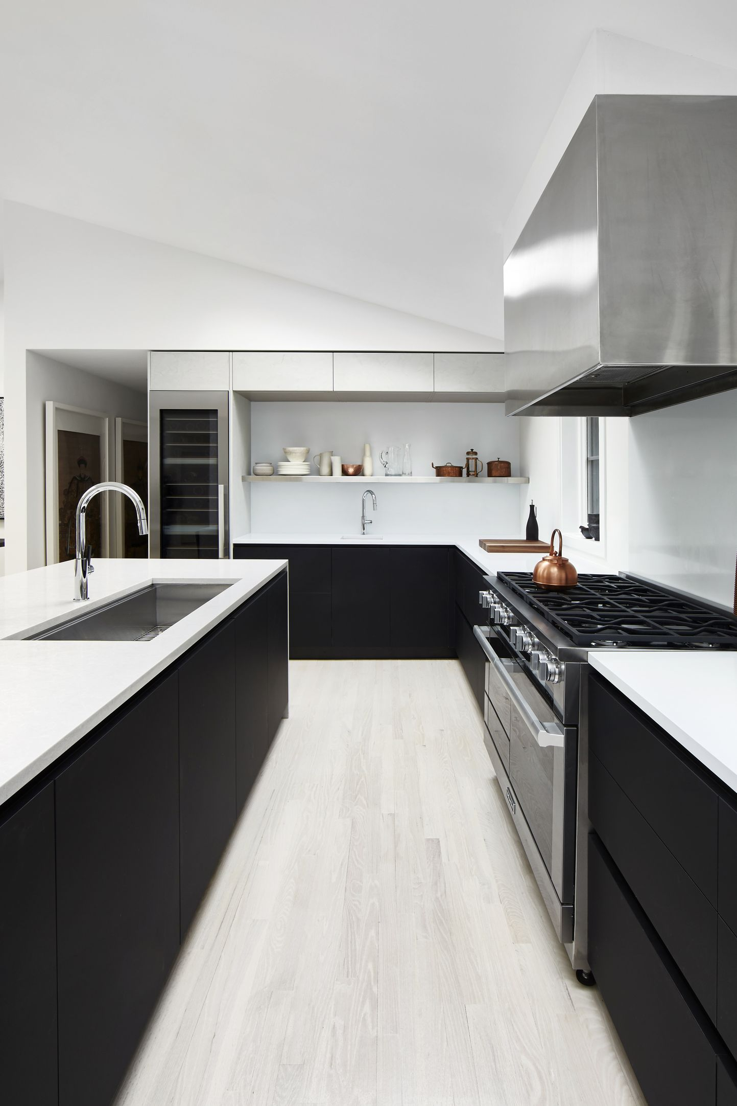 modern minimalist kitchen in black with stainless steal