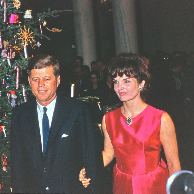 this photograph by george f mobley shows president john f kennedy and first lady jacqueline kennedy attending the white house staff christmas reception the reception took place on december 12, 1962 in the entrance hall of the white house this would be their last christmas celebration in the white house