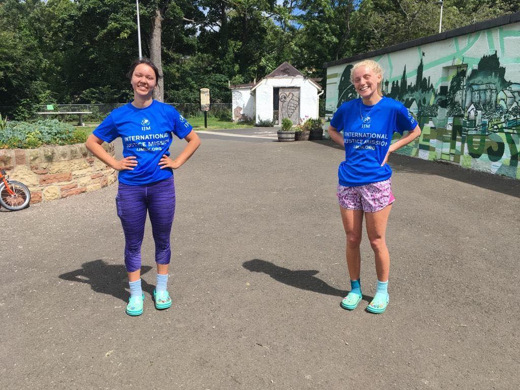 Best friends run marathon in Crocs