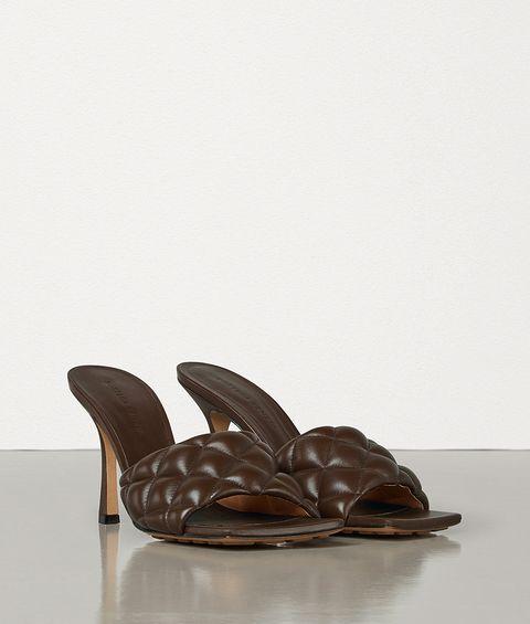 Footwear, Brown, Shoe, Bronze, Bronze sculpture, Sculpture, Leather, Still life photography, Furniture, Slipper,