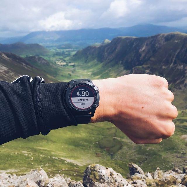 Mountainous landforms, Wrist, Watch, Hand, Highland, Hill, Ridge, Analog watch, Watch accessory, Clock,