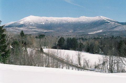Snow, Mountain, Winter, Mountainous landforms, Sky, Tree, Wilderness, Slope, Mountain range, Geological phenomenon,
