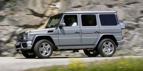 Land vehicle, Vehicle, Car, Mercedes-benz g-class, Automotive tire, Sport utility vehicle, Tire, Wheel, Mercedes-benz, Luxury vehicle,